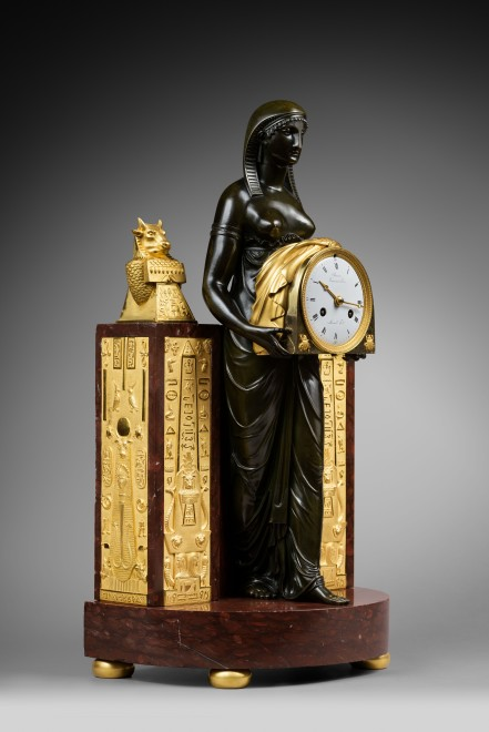 An Empire Pendule à L'Egyptienne, movement by Mesnil, case by Ravrio