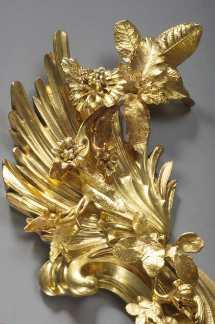 A pair of Louis XV three-light wall-lights attributed to Jacques Caffiéri