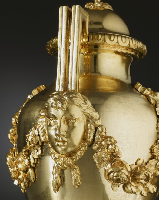 A pair of Louis XVI covered urns