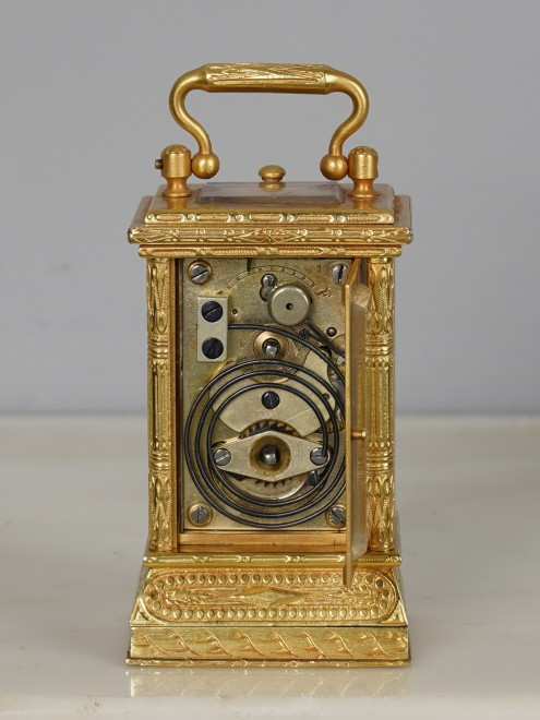 A miniature carriage clock with digital dial