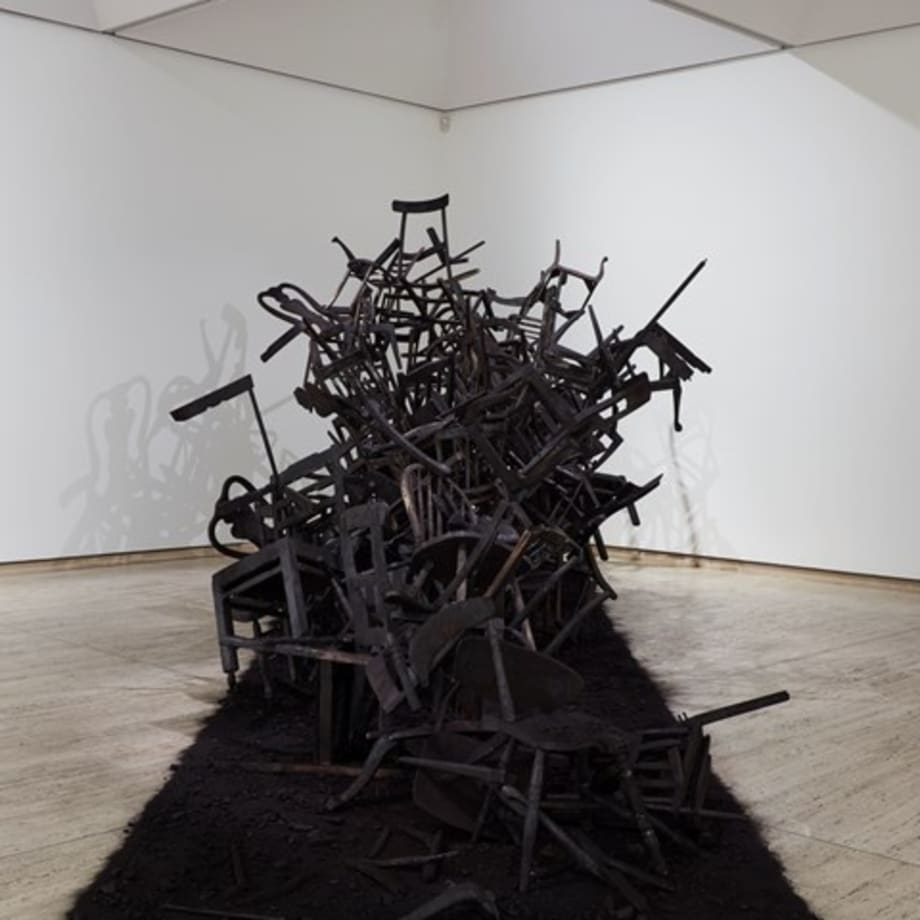 Rushdi Anwar, Irhal (Expel), Hope and the Sorrow of Displacement (2013–ongoing). Burnt wooden chairs, black oxide pigment, charcoal, ash. Dimensions variable. Exhibition view: The National 2019: New Australian Art, Art Gallery of New South Wales, Sydney (29 March–21 July 2019). © Rushdi Anwar.