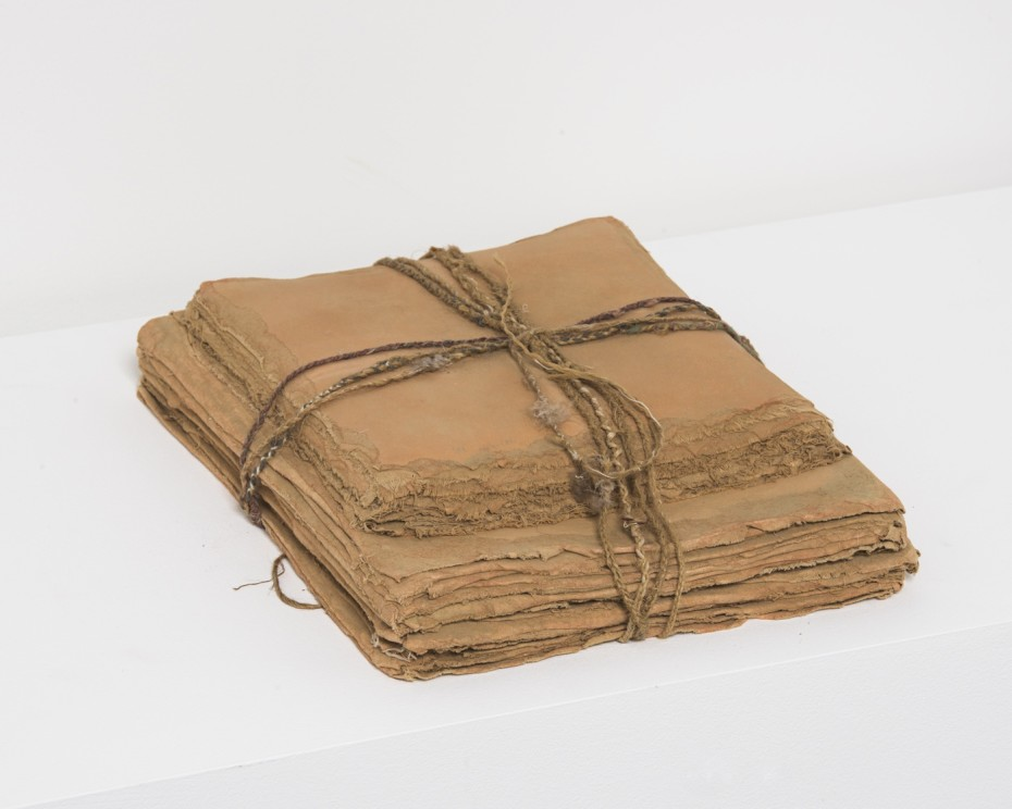 <div class=&#34;title&#34;><em>The Pen Argyl Myth</em>, 1977</div><div class=&#34;medium&#34;>Earth and feathers from Pen Argyl Quarry, Pennsylvania, woven string, muslin-mounted rag paper</div><div class=&#34;dimensions&#34;>34.3 x 26.7 x 8.9 cm, 13 1/2 x 10 1/2 x 3 1/2 ins</div><div class=&#34;dimensions&#34;>&#169; Michelle Stuart</div>