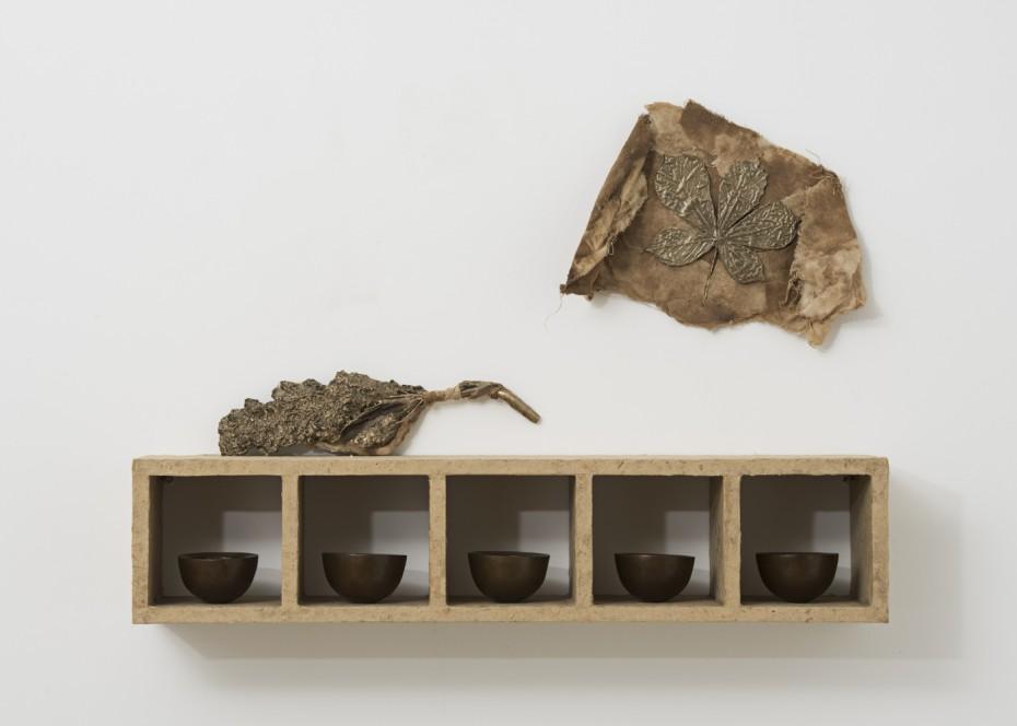 <div><em>Esca</em>, 1997</div><div>polished patinated bronze, horse-chestnut seeds, bali-paper, cloth, wood</div><div>33 x 61.6 x 13.7 cm, 13 x 24 1/4 x 5 3/8 ins</div><div>&#169; Michelle Stuart</div>