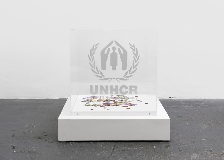 Contribution Cube (UNHCR), 2004/2016  plexiglass vitrine, vinyl sticker, wood base  79.0 x 76.0 x 76.0 cm 31 1/16 x 29 7/8 x 29 7/8 in.