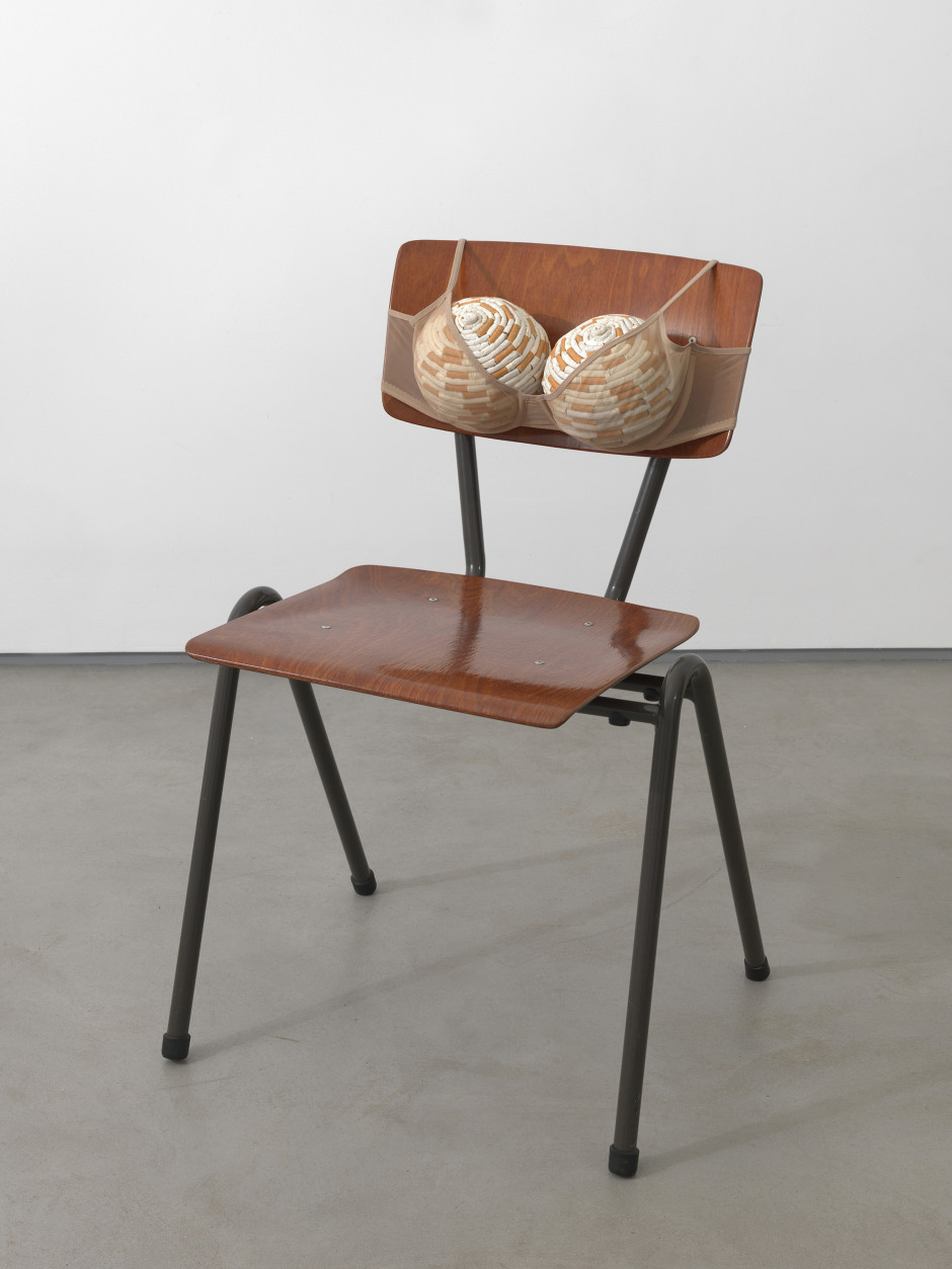 Cigarette Tits I [ -> Idealized Smokers Chest I], 1999  bra, footballs, cigarettes, chair  78.5 x 50.0 x 54.0 cm 30 7/8 x 19 5/8 x 21 1/4 in.