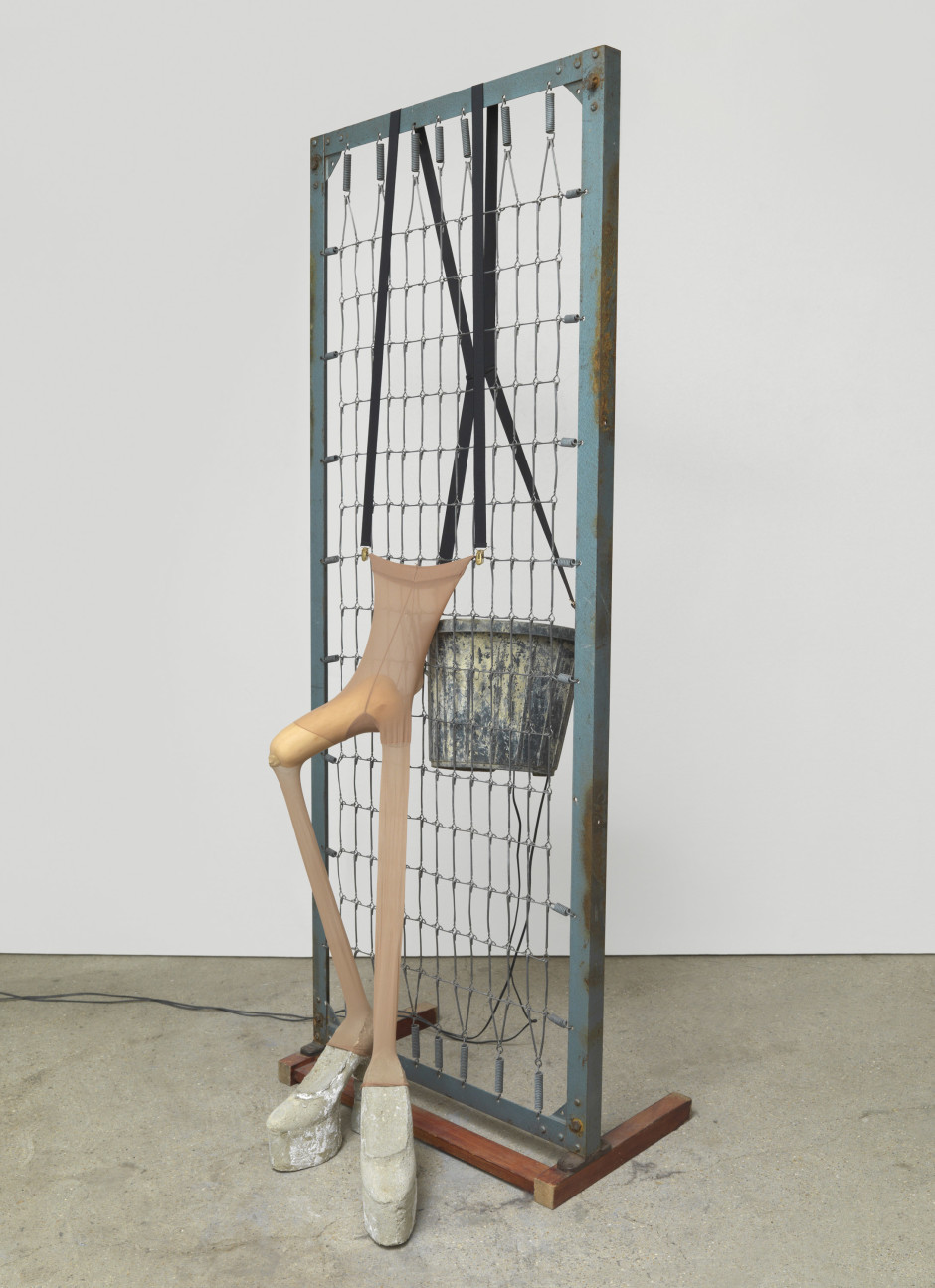 Man versus human nature-2012, 2005  plastic bucket, wood and steel bed base, braces, cement, nylon tights, butternut squash  194.3 x 76.2 x 45.7 cm  76 ½ x 30 x 18 in.
