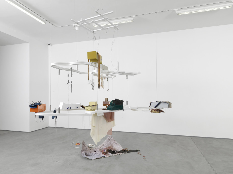 Full of frozen food, 2014  Welded, bent and powder coated stainless steel; hardwood; tray; leaves; perfume bottle; printed Tyvek; ballchain; dried flowers; sandblasted aluminium; oyster shells; beetles; vinyl; stitched fabric; zips; welded chromed nuts and bolts; eggs; latex; water  302.5 x 273.0 x 210.0 cm 119 1/16 x 107 7/16 x 82 5/8 in.