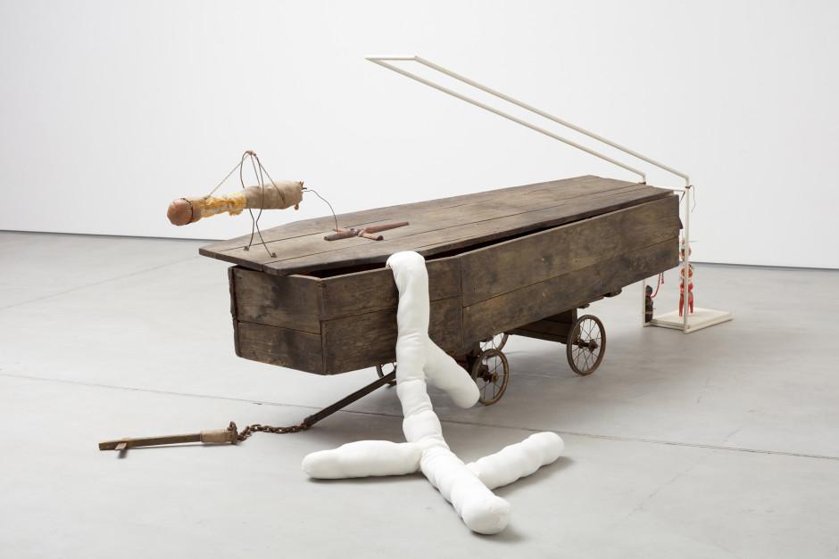 The Coffin 21 gram, 2017  wood, wood stain, fabric, metal chain, wheel cart, jute, painted metal rack, bone  123 x 317 x 170 cm  48 ½ x 124 ¾ x 67 in.