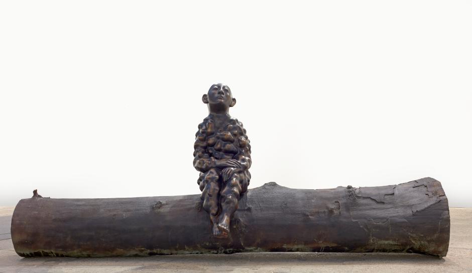 Bumpman on a tree trunk, 2018  bronze  182 x 437 x 122 cm / 71 ⅝ x 172 ⅛ x 48 ⅛ in