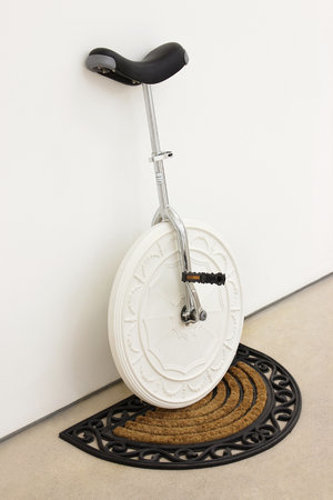 <p>Richard Slee, Unicycle, 2012, plaster, unicycle parts, doormat, wood, 103 x 74 x 44.5 cm</p>