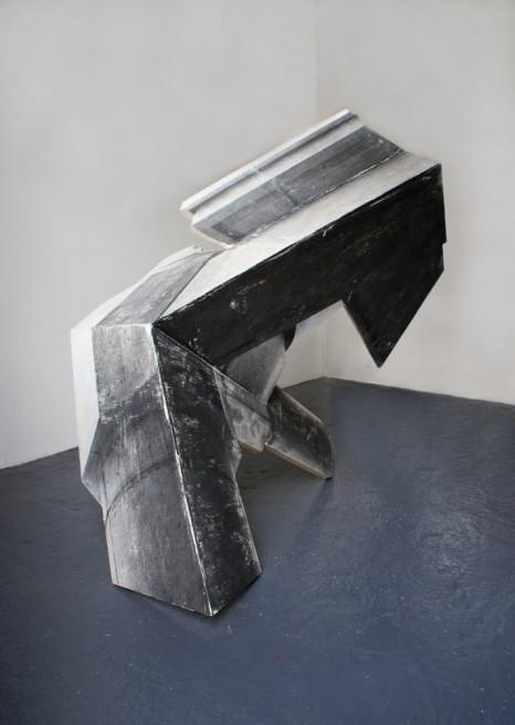 """<div class=""""artist""""><strong>Neil Ayling</strong></div> <div class=""""title""""><em>Obi</em>, 2011</div> <div class=""""medium"""">Plywood, matte acrylic, medium, b/w toner print</div> <div class=""""dimensions"""">83 x 128 x 180cm</div>"""
