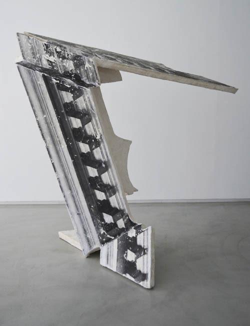 """<div class=""""artist""""><strong>Neil Ayling</strong></div> <div class=""""title""""><em>Ionic</em>, 2013</div> <div class=""""medium"""">Jesmonite and Image Transfer</div> <div class=""""dimensions"""">183 x 200 x 121 cm</div>"""
