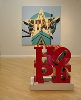 "Installation view of Robert Cottingham's ""Aqua Star"" and Robert Indiana's ""HOPE"""