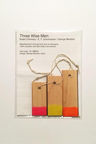 "<div class=""artist""><strong>Michael Marriott</strong></div><div class=""title""><em>Three Wise Men: Noam Chomsky / E.F. Schumacher / George Monbiot</em>, 2019</div><div class=""medium"">Recycled Pine and Mahogany</div>"
