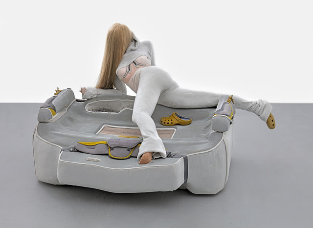 Anna Uddenberg Disconnect (airplane mode), 2018 styrofoam, polyurethane foam, acrylic resin, fiberglass, plaster, car interiors, wall-to-wall carpet, baby carrier backpack, vinyl foam stripes, linoleum, flooring, mesh fabric, velour fabric, synthetic hair, acrylic nails, mountain bike helmet parts, paint 119 x 196 x 185 cm 46 7/8 x 77 1/8 x 72 7/8 in