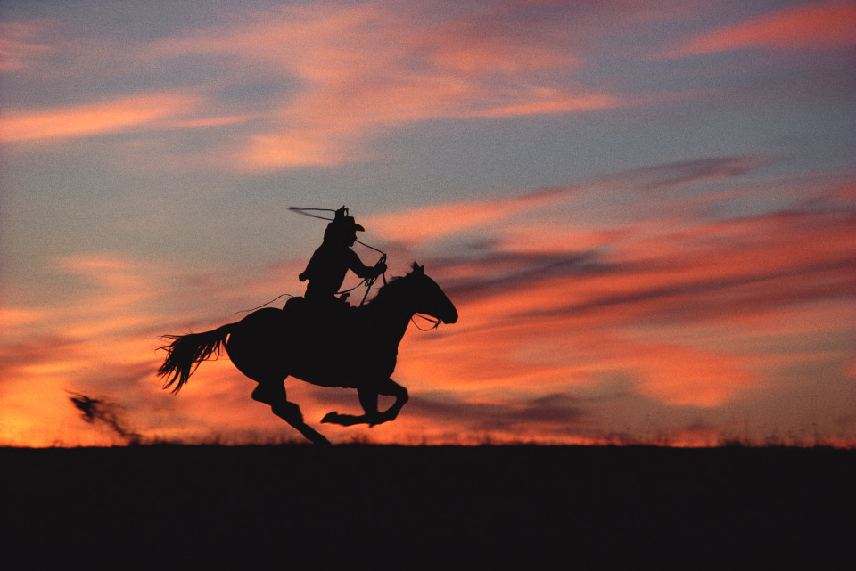 Image: Norm Clasen  Sunset Chase, Riverton, WY, 1985  signed, titled, dated and numbered on artist label verso  archival pigment print  40 x 60 inches, edition of 5 plus 2 artist's proofs  26.5 x 40 inches, edition of 9 plus 2 artist's proofs  16 x 24 inches, edition of 15 plus 2 artist's proofs