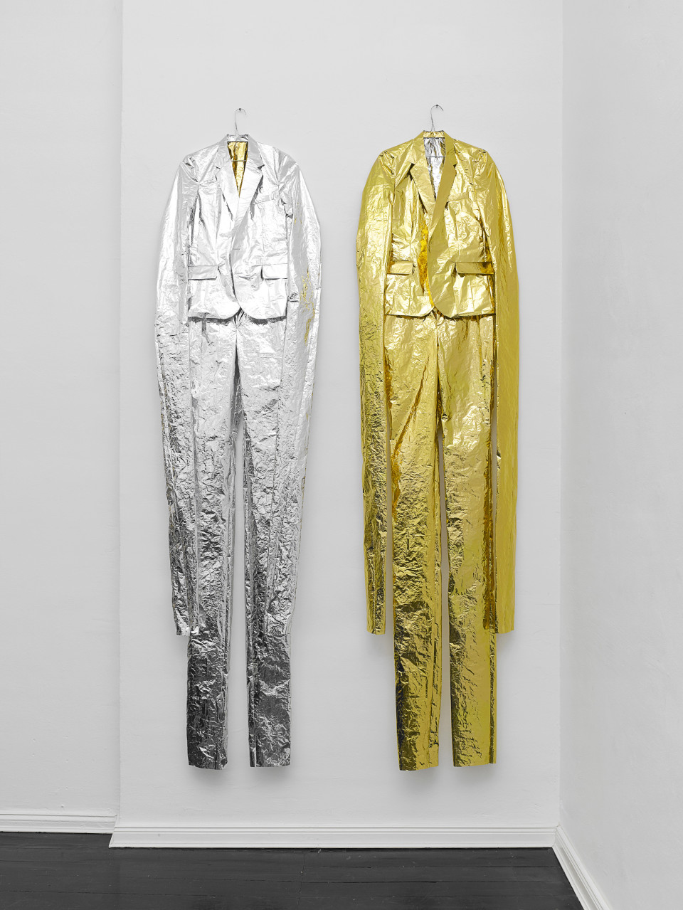 Fiete Stolte Suits, 2012 Signed and numbered certificate 2 Tailor made suits (each consisting of jacket and trouser) Made from rescue sheet Each ca. 210 x 60 cm In a custom made box Edition of 10