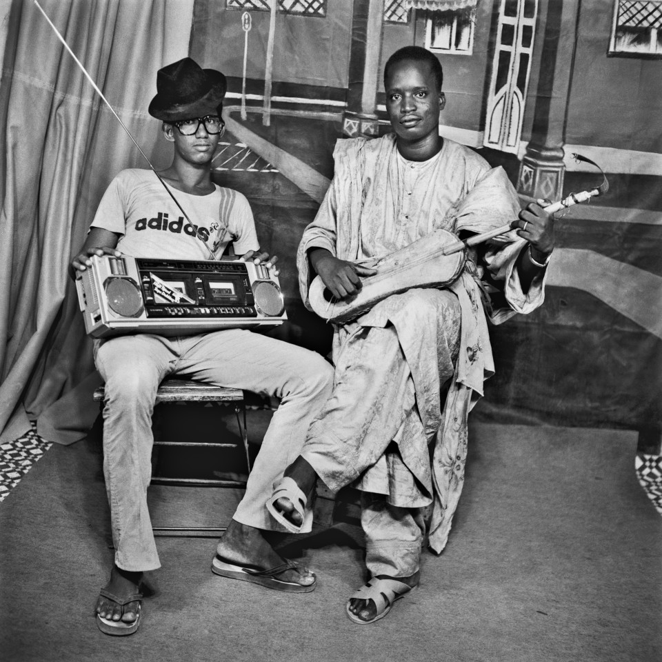 Image: Sanlé Sory  Mali Djeli, 1984  signed, dated, titled and numbered verso  gelatin silver print  image size: 14-1/2 x 14-1/2 inches (36 x 36 cm) paper size: 20 x 16 inches (50 x 40 cm)  edition of 15 plus 5 artist's proofs