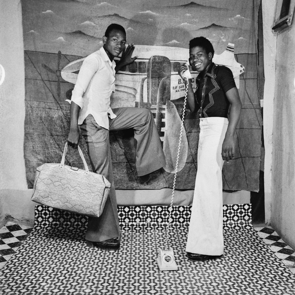 Image: Sanlé Sory  Allo, on arrive!, 1978  signed, dated, titled and numbered verso  archival pigment print  42 x 42 inches, edition of 9 plus 3 artist's proofs  gelatin silver print  24 x 20 inches, edition of 10 plus 3 artist's proofs 20 x 16 inches, edition of 15 plus 5 artist's proofs