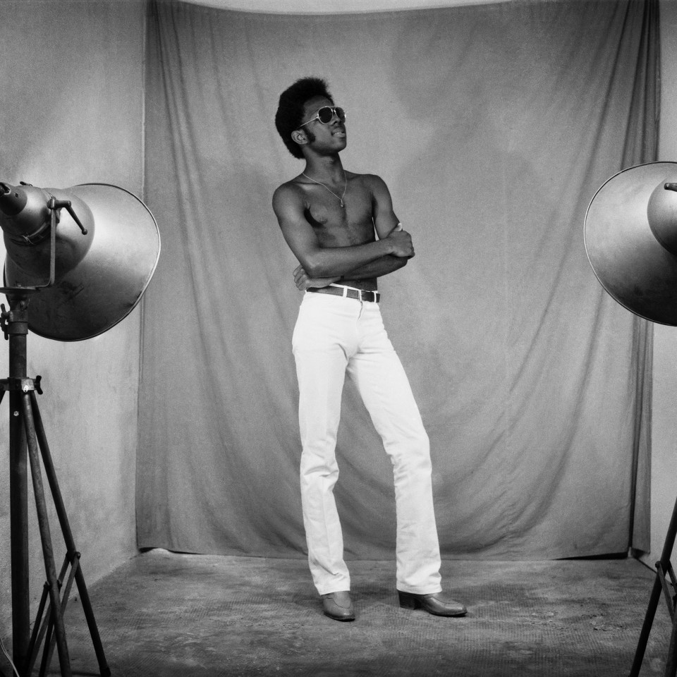 Image: Sanlé Sory  Elvis, 1974  signed, dated, titled and numbered verso  archival pigment print  42 x 42 inches, edition of 9 plus 3 artist's proofs  gelatin silver print  24 x 20 inches, edition of 10 plus 3 artist's proofs 20 x 16 inches, edition of 15 plus 5 artist's proofs