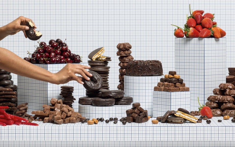 Image: Charlie White  Still Life of Chocolates with Taker, 2014  chromogenic print  20 x 32 inches  edition of 5 with 2 artist's proofs