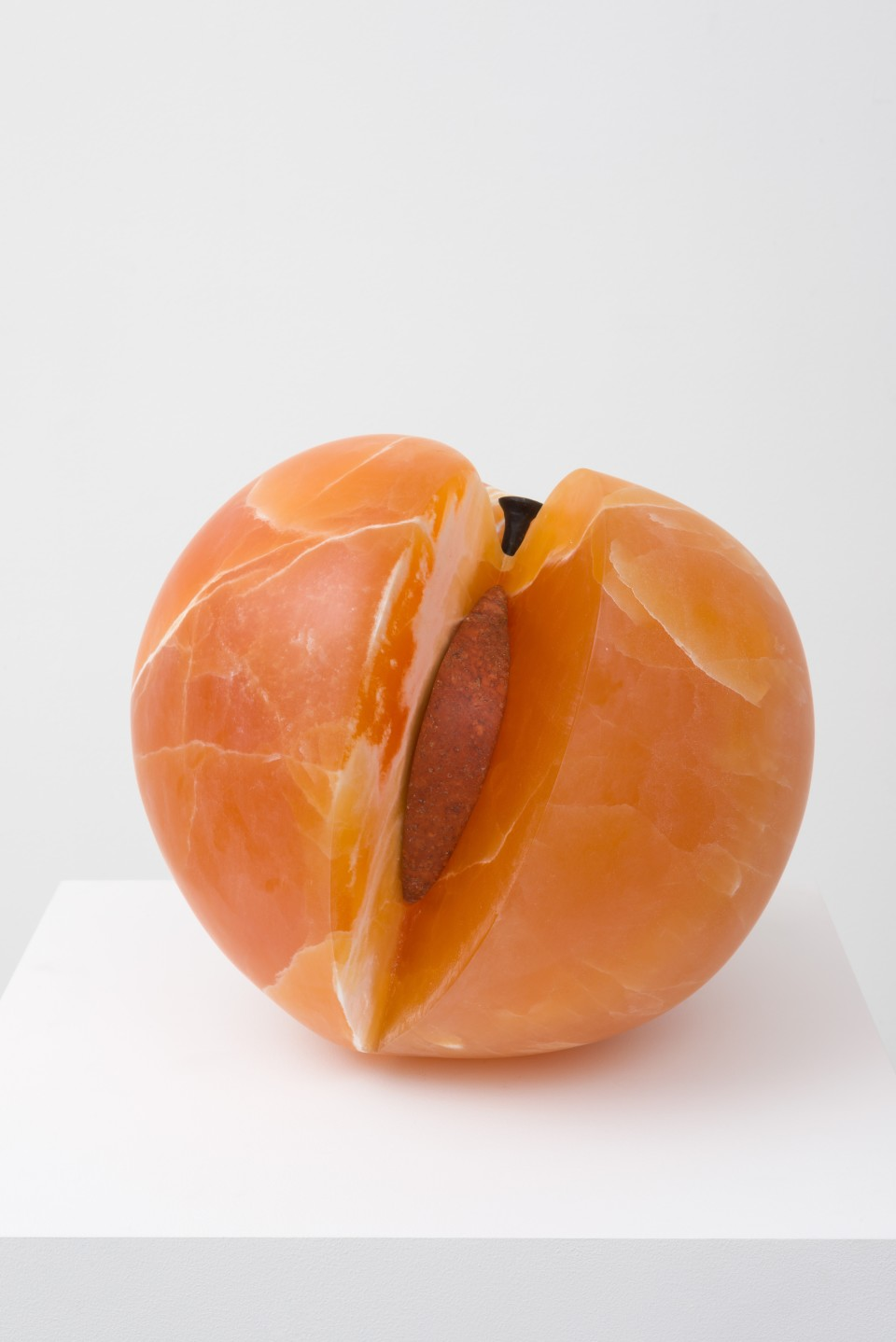 Image: Nevine Mahmoud  Peach with Erotic Inside, 2017  calcite, steel, travertine and glue  13 x 13 x 13 inches
