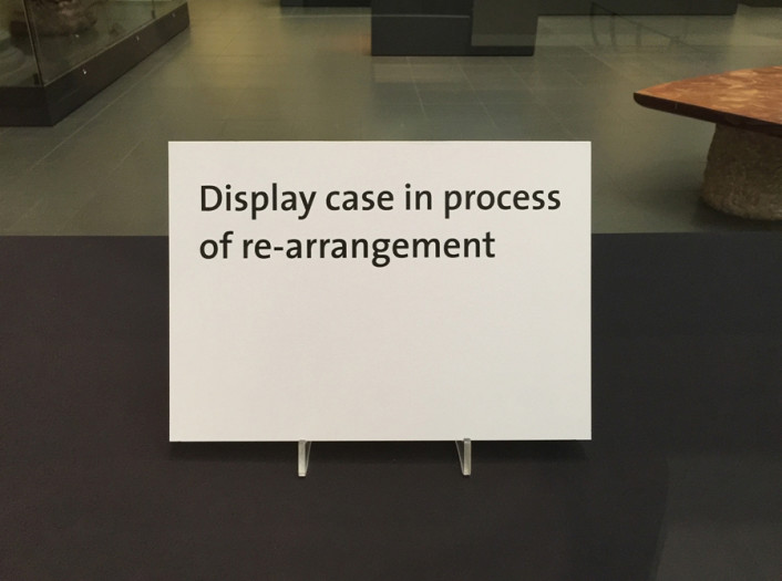 Display case in process of re-arrangement ('China', V&A Museum, 22 February 2016)