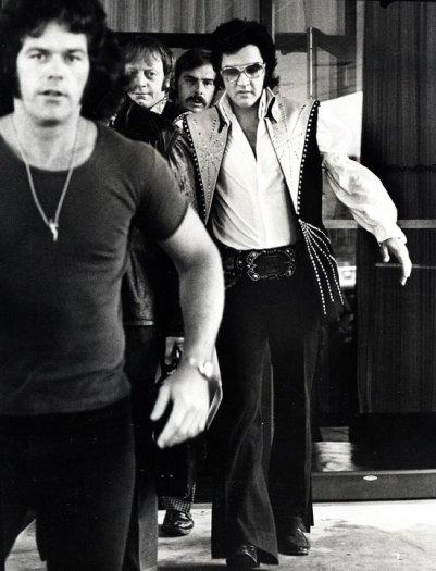 Ron Galella, Elvis and bodyguards depart the Hilton Hotel, Philadelphia, PA, June 25, 1974