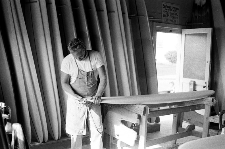 LeRoy Grannis, Hap Jacobs at his shop, Hermosa Beach, 1963