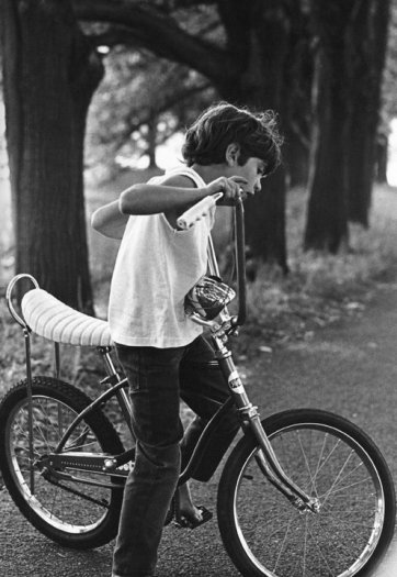 John F. Kennedy Jr on his bicycle in Peapack, New Jersey, May 6