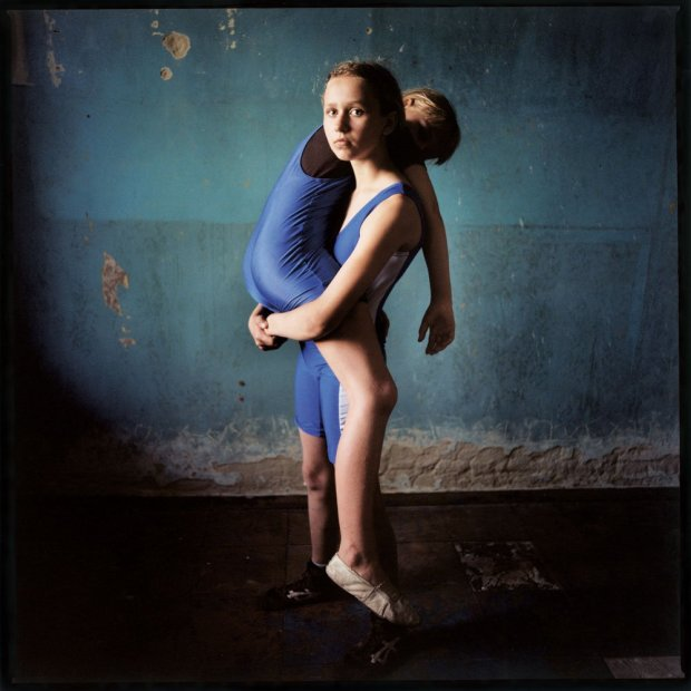 Michal Chelbin Girl Lifting a Girl, Ukraine chromogenic print 37 x 37 inches