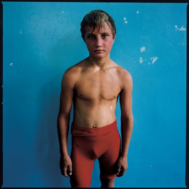 Michal Chelbin Red-Faced Boy, Ukraine chromogenic print 37 x 37 inches