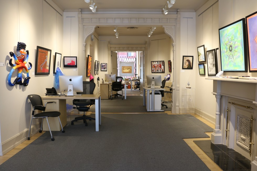 Paintings by Lower Canada College art students hang on the walls of Alan Klinkhoff Gallery Montreal.